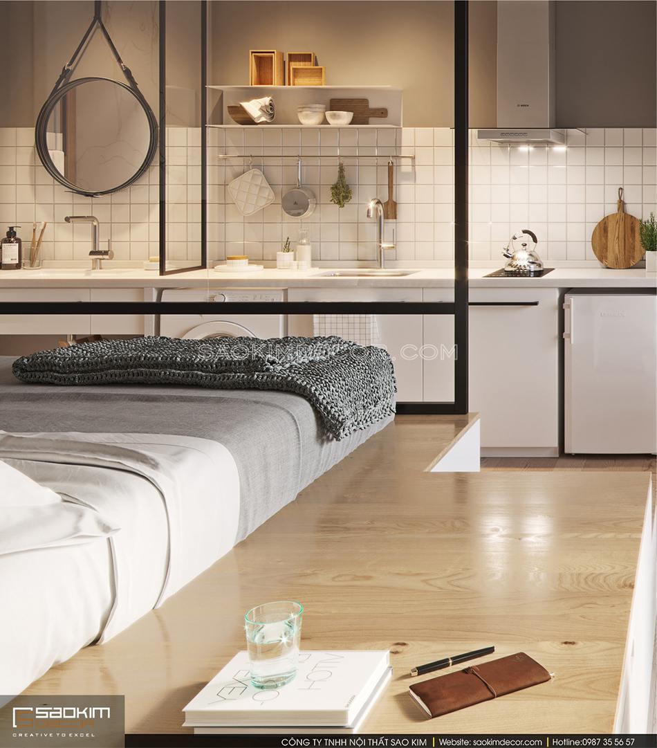 Khu vực giường ngủ được làm cao trên sàn gỗ và ngăn cách với các không gian khác bằng kính trong suốt