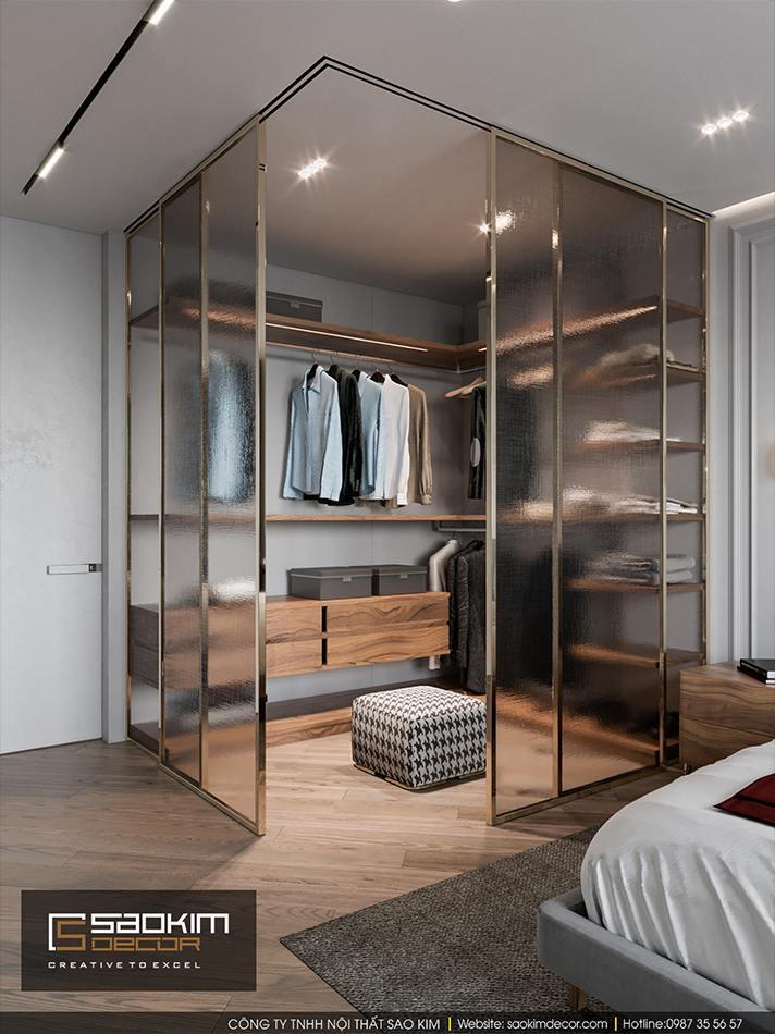 Thiết kế phòng ngủ master với phòng thay đổ nhỏ được ngăn bởi các khung kính