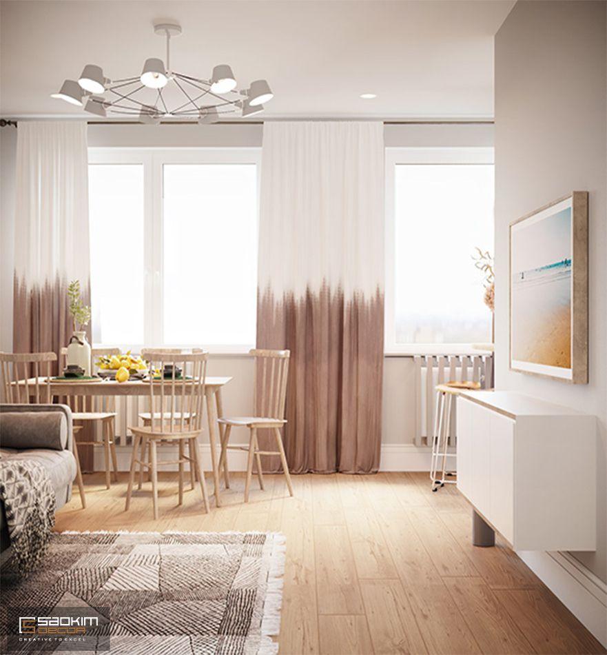 Bàn ăn được đặt ngay cạnh cửa sổ trong thiết kế căn hộ 80m2