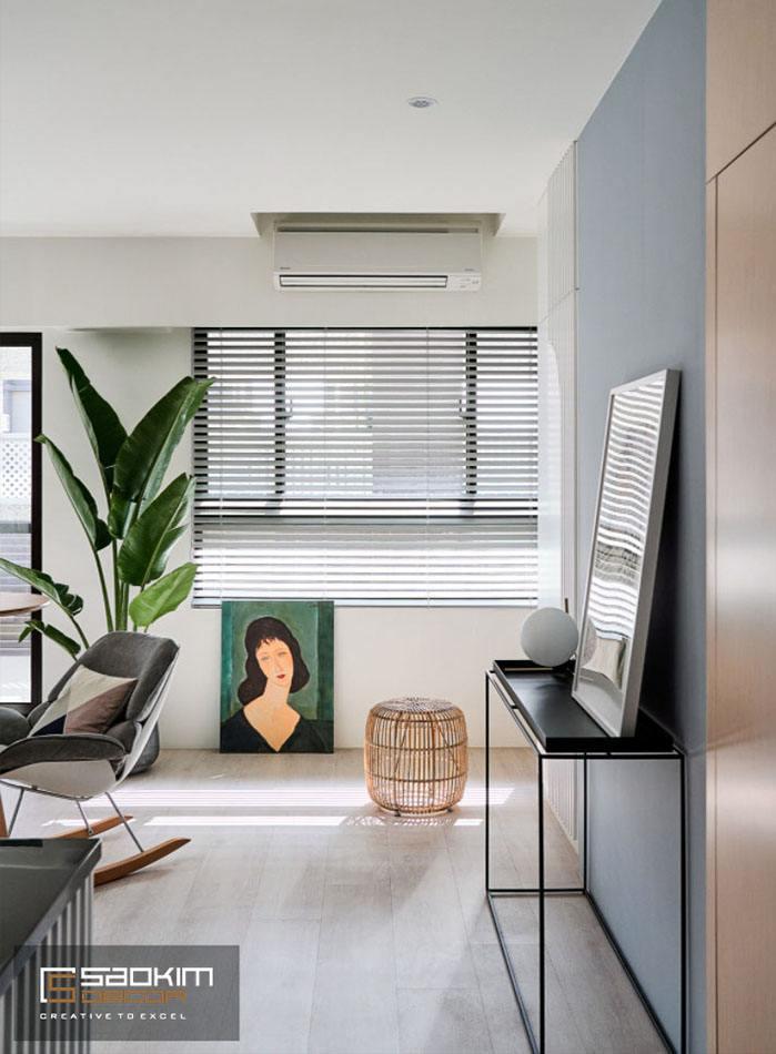 Không gian thư giãn nhỏ cho các thành vieenc trong căn hộ tận dụng khoảng trống của bếp và phòng khách